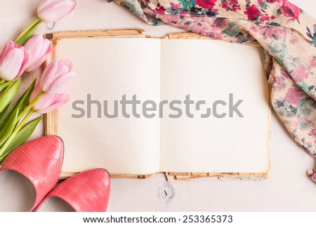 Pink tulips with ballerinas shoes over white wooden table background - stock photo