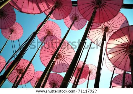 Pink umbrella - stock photo