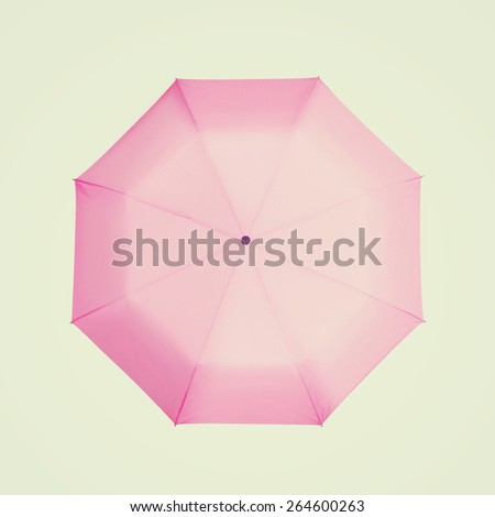 pink umbrella, vintage style - stock photo