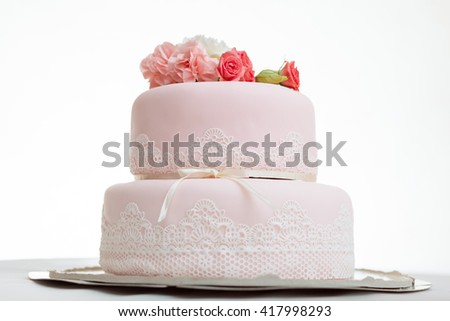 Pink wedding cake with roses against  white isolated background - stock photo