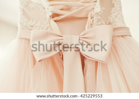 pink wedding dress with bow - stock photo