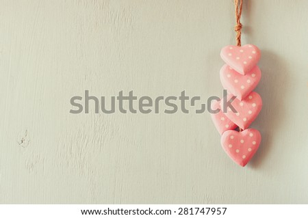 pink wooden hearts over wooden aqua background - stock photo