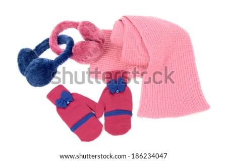 Pink wool scarf, a pair of gloves and earmuffs nicely arranged. Winter accessories isolated on white background. - stock photo