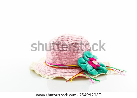 Pink woven hat on white background.  - stock photo