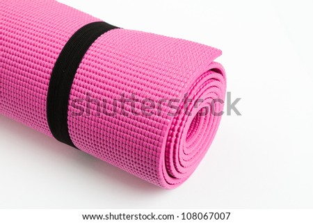 Pink Yoga Mat with White Background - stock photo