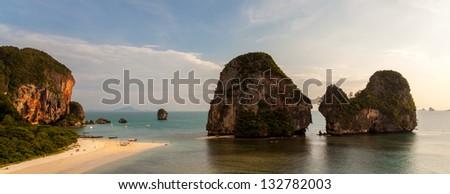 Pinnacles at Pranang beach, Railay. Considered one of Thailands most beautiful beaches. - stock photo
