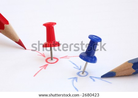 pins and pencils show you our two targets in different areas - stock photo