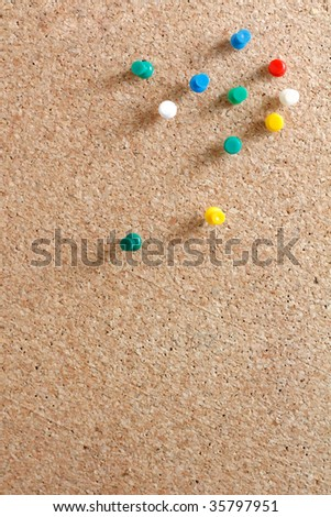 Pins on a wooden notice board - stock photo