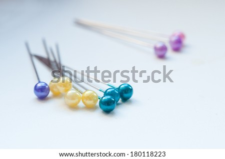 Pins with colourful heads isolated on white background - stock photo