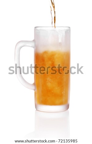 pint of beer served in a frosted stein glass. - stock photo