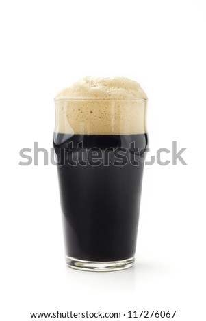 pint of dark beer isolated on white background - stock photo