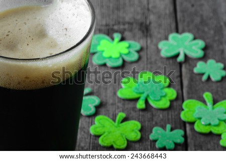 Pint of Stout Beer with Green Shamrock - stock photo