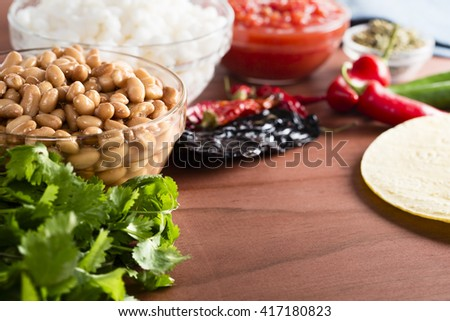 Pinto beans and other ingredients for Mexican cooking. - stock photo