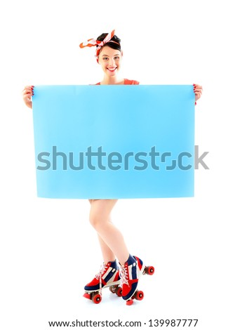 Pinup girl in retro roller skates holding empty banner, full length portrait of young happy sexy woman in pin-up style, vintage stylization over white - stock photo