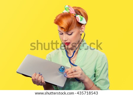 Pinup girl listening computer with stethoscope looking at pc vintage hairstyle yellow wall. Healthcare diagnosis software repair diagnostics internet threat security safety problem solving concept - stock photo