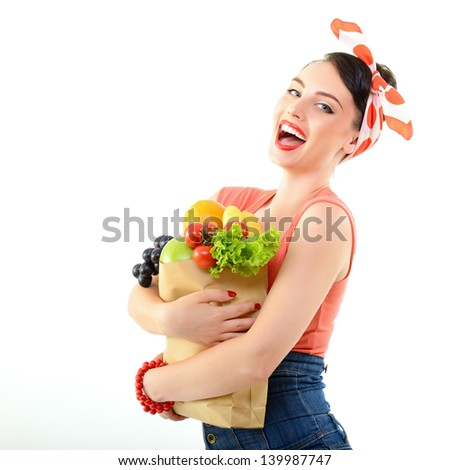 Pinup girl with food bag, portrait of young happy sexy woman in pin-up style, over white - stock photo
