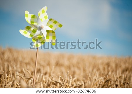 Pinwheel in a field - stock photo