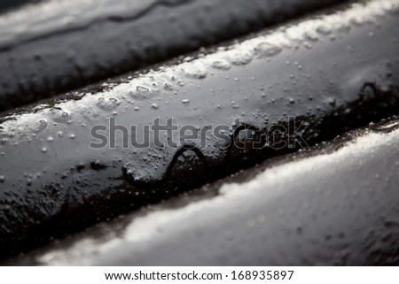 pipe covered with a layer of oil - stock photo