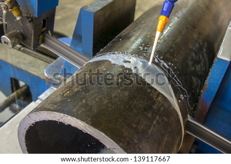 pipe cutting with power saw - stock photo