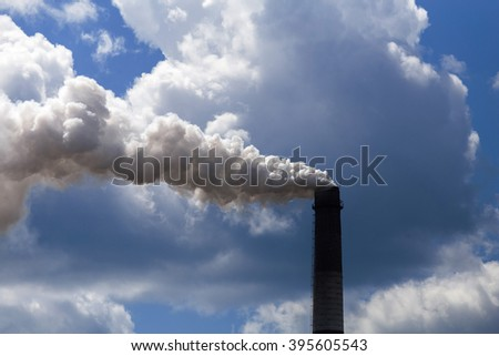 Pipe heavy industry factory emits into the air precipitation, smog and gas, polluting the planet - stock photo