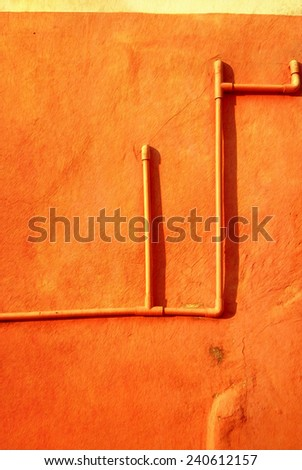 pipe on colorful wall in painting style  - stock photo