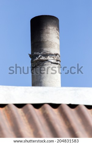pipe on the roof - stock photo
