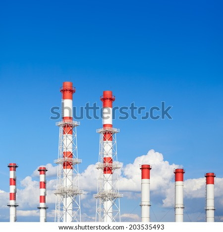 pipe power plant against the sky - stock photo