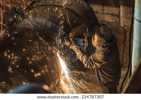 Pipe welding on the pipeline construction site  - stock photo