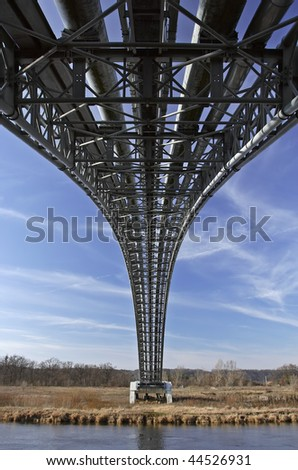 pipeline cross the river - stock photo