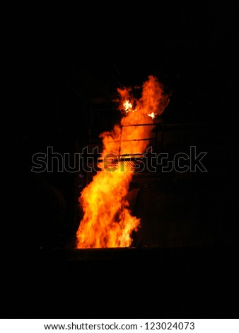 Pipeline, fire and smokestack, props supporting metal structural, plant through works emits into the environment residues production, combustion gas, refineries - stock photo
