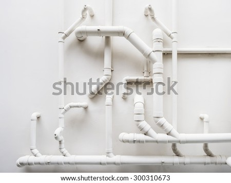 Pipeline Plumbing system on white wall - stock photo