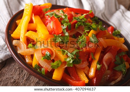 Piperade: peppers with tomatoes and onions close up on a plate. horizontal