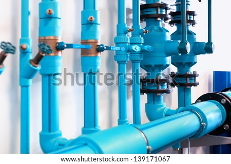 Pipes and valves of heating system - stock photo