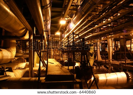 Pipes inside energy plant - stock photo