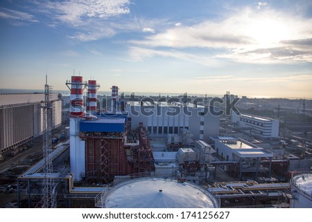 pipes of thermal power plant and and city - stock photo