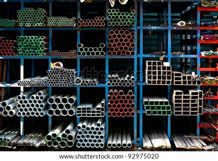 Pipes stacked up in a factory - stock photo