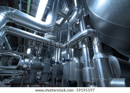 Pipes, tubes, machinery and steam turbine at a power plant - stock photo