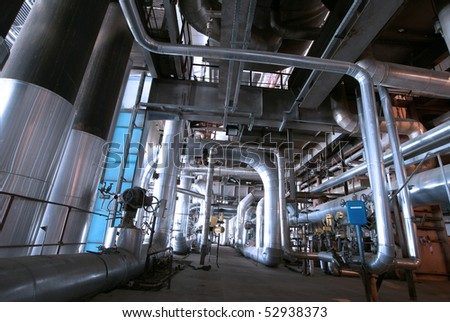 Pipes, tubes, valves, cables at a power plant - stock photo