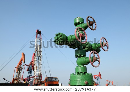 Piping and valves of oil field, close-up - stock photo