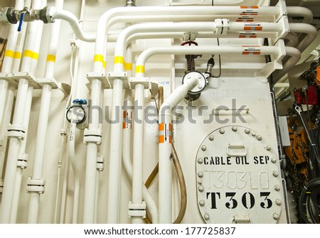 Piping connection Engine Room Spaces on a modern vessel - engineering interior including pipes, cables, pumps - stock photo