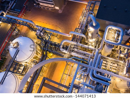 piping system in industrial plant from above - stock photo