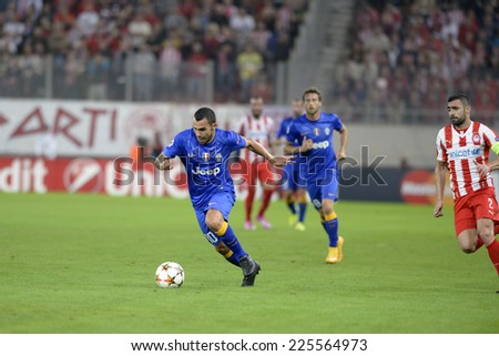 Piraeus, Greece Oct. 22, 2014.Juventus Carlos Tevez, with the ball, during t the Champions League football match between Olympiakos vs Juventus (1-0) at Karaiskaki Stadium in Piraeus - stock photo