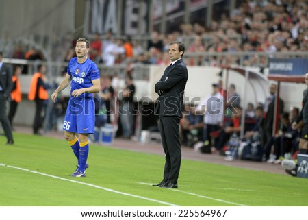 Piraeus, Greece Oct. 22, 2014.Juventus coach Massimiliano Allegri and Stephan Lichtsteiner during t the Champions League  match between Olympiakos vs Juventus (1-0) at Karaiskaki Stadium in Piraeus - stock photo