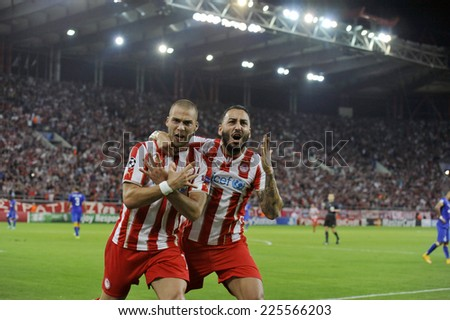 Piraeus,Greece Oct. 22, 2014. Olympiakos' Pajtim Kasami, left, celebrates besides teammate Kostas Mitroglou after scoring his opening goal during the soccer match between Olympiakos and Juventus  - stock photo