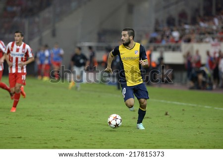 Piraeus,Greece Sept 16, 2014. Atletico's Arda Turan during the Champions League soccer match against Olympiacos at Georgios Karaiskakis Stadium in the port of Piraeus near Athens.  - stock photo