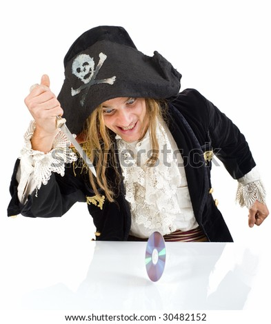 pirate aiming a knife at CD - stock photo