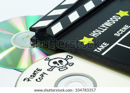Pirate Copy written on a dvd next to a clapper board - stock photo