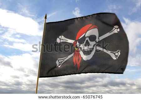 Pirate flag and clouds - stock photo