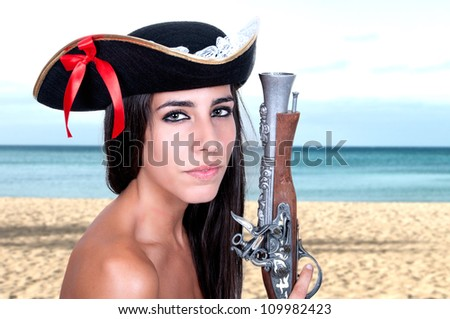 pirate girl on the beach - stock photo