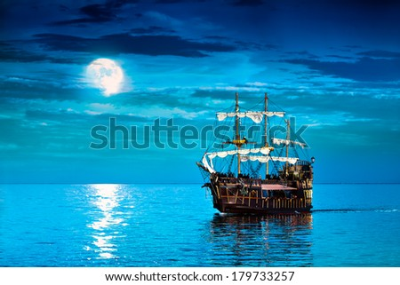 Pirate ship and moon, sailing Flying Dutchman frigate - stock photo